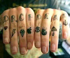 Oli Sykes finger tattoos