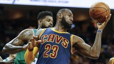 Cavaliers' LeBron James drives to the basket between Celtics' Marcus Smart (36)