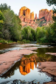 The red rocks of Sedona, Arizona reflected on water during a calm fall day