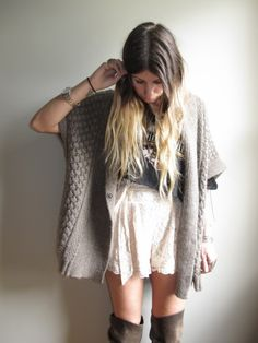 Sweater cardi, t-shirt tucked into a high waist skirt, over the knee boots. Bohemian grunge.