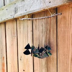 A waterfall of ceramic fans, attached to a branch with flax cord. Home decor Wind Chimes, Cord, Waterfall, Artisan, Fans, Etsy Shop, Ceramics, Outdoor Decor, Vintage