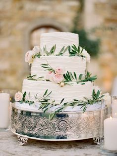 White Wedding Cake with real flowers and greenery