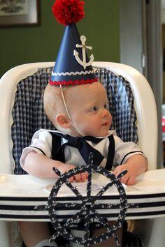 love the nautical birthday highchair decor