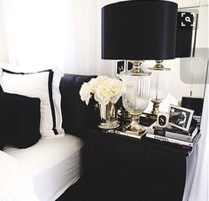 white bed•black nightstand•black lamp•gold accent
