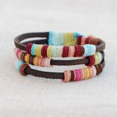 These are crochetted. Cool, mini leather bracelet by kjoo!