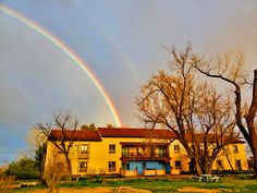 The west facade of La Posada graced with a rainbow as seen from the Cottonwood Grove Facade, Restoration, Walking, Rainbow, Mansions, House Styles, Image, Rain Bow, Rainbows