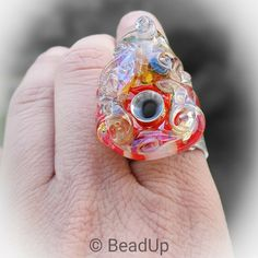 Big, organic lampwork bead riveted on a patterned 15 mm silver band