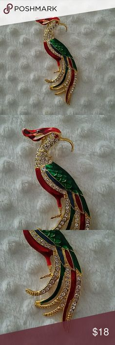 """Beautiful Vintage Rhinestone  Bird Brooch NEW Beautiful Vintage Rhinestone  Bird Brooch NEW. This beautiful red green and blue colors along with rhinestones. Approx. 1.25""""×4"""". This is part of a jewelry collection my mother never wore Jewelry Brooches"""