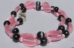 Beautiful pink and black cats eye necklace