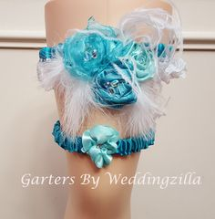 Shades of Aqua blue, turquoise, white lace and feathers in this one of a kind feather and flower #wedding #garter set.   The garter has a turquoise satin band and vintage unu... #bride #bridal #hairpiece #weddings #ido #weddinggarter ➡️ http://jto.li/CFWUG