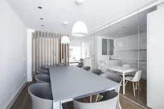 Ático en Valencia: Comedor de estilo  de Hernández Arquitectos