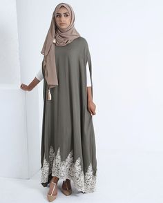 Olive Lace Appliqué Cape Dress has now been restocked in all sizes.