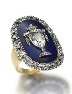A late 18th century enamel and diamond memento mori (Latin: remember that you will die) / mourning ring The oval royal blue guilloché enamel plaque applied with a central pear-shaped and rose-cut diamond urn motif, within a border of old brilliant-cut diamonds in closed-back settings, mounted in silver and gold, hoop probably later, ring size G (leading edge), cased by Elkington and Co Ltd of Regent Street.