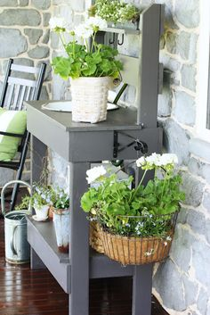 Grey painted potting bench.