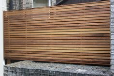 Decoration. Wall Decoration Ideas Come With Wooden Fence As Privacy Screen Panel And Grid Ceramic Flooring Material.