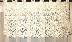 Adapted from a traditional English lace stitch, this valance is a much easier knit than it looks (if you've done a bit of lace-knitting), and is knit from side to side, thus making it very easy to knit for a wider window or door.