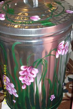 Of course I wouldn't put trash in this beautifully painted trash can. Consider it for storage, maybe potting soil, or even outdoor toys, furniture cushions, or gardening items.