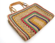 Vintage woven cane purse with bamboo handles on Etsy- come to mama!