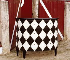 Harlequin bow-front chest... grunge it up a little and it'd look GREAT in a steampunk room  :)