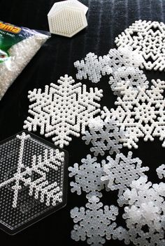 Fusible bead snowflakes - wonder if i could get Courtney Reiff to make some for me... need to get the white beads...