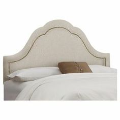 "Nailhead-trimmed high arch headboard with a pine wood frame and foam cushioning. Handmade in the USA.  Product: HeadboardConstruction Material: Pine wood, metal and polyurethane foam Color: TalcFeatures: Handmade in the USA Dimensions:   Twin: 58"" H x 41"" W x 4"" D   Full: 58"" H x 56"" W x 4"" D  Queen: 58"" H x 62"" W x 4"" D   Cleaning and Care: Spot clean only"