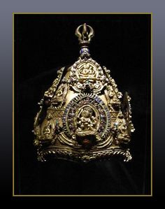 Vajracarya's ritual crown, Napal, Early Malla period, 13th-14th Century, Gilt copper-alloy inlaid with gems. Elaborate crowns such as this were worn by Vajracarya priests, the highest rank in the Napalese Buddhist community. The term Vajracarya denotes both a caste and a family name, and the designation entitles its holders to preform reserved priestly functions --analogous to the privileges of Brahmans in Hinduism.
