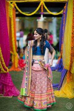 Mehendi Outfits - Bride in a Multi Colored Lehenga with a Blue Choli | WedMeGood #wedmegood #indianbride #indianwedding #lehenga #lightlehenga #colorful #bridal