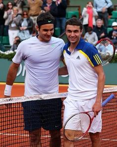 Sunday June 2 2013. Federer's 900th Career Match. The one he almost lost. The first time I've seen him fall. Hopefully his ankle is all right. They went 5 sets. Gilles is one of France's top male players - a great counterpuncher. Roger Federer and Gillou (Gilles SImon). Roland Garros.