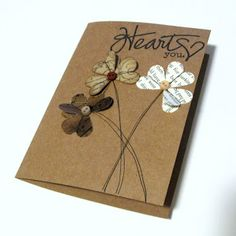 Use a small heart punch to make flowers - love the small buttons in the centers