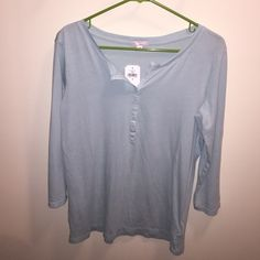 Pastel teal Henley from Gap This classic Gap Henley is a beautiful soft, pastel teal which is lightweight and loose. Could be worn for casual wear or pajamas. Note that the dye used in the product is prone to crocking or color transfer. GAP Tops
