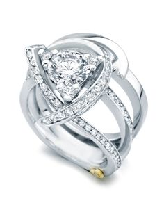 'Luxury' - LOVE how three small diamonds make the center stone into a triangle! I'm lucky to have a real trillion cut ring.