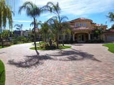Holy moly, that is a LOT of pavers! Interlocking Pavers, Concrete Pavers, Driveways, Yard Ideas, Curb Appeal, Landscapes, Mansions, House Styles, Design