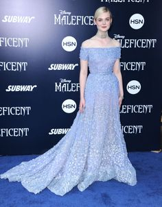 Elle Fanning wearing a gorgeous off-the-shoulder periwinkle gown at the world premiere of Maleficent in Hollywood. See all of the actress's best looks. Celebrity Gowns, Celebrity Red Carpet, Celebrity Style, Gala Dresses, Red Carpet Dresses, Elle Fanning, Red Carpet Looks, Red Carpet Fashion, Special Occasion Dresses