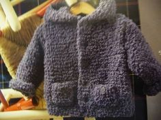 """A """"Teddy"""" jacket for baby size 3 months to 2 years, needles n ° 5 The Malle with a thousand stitches Source by Cardigan Bebe, Baby Cardigan, Patron Crochet, Knit Crochet, Knitting For Kids, Baby Knitting Patterns, Tricot Baby, Bebe Baby, Baby Sewing"""