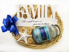 A beautiful 'Family' shaped standing ornament and a scented soy candle in a glass jar with a lid make up this gorgeous The Gift of Family basket! Perfect for the family members you really want to show you care!  Price: 19.99 http://luxuryhampers.ie/p/the_gift_of_family_basket