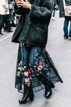 Tips for how to wear a dress over jeans, the styling trick which we've spotted all over London in 2017.