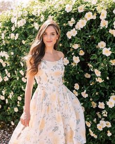 This is the Abigail dress (a sweet linen fabric covered in yellow dahlias) and shes just a ray of sunshine