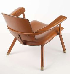 Jacques Adnet; Leather and Brass Lounge Chair, c1950.