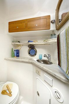 The head on the Express Cruiser 340 has solid surface counters, a gelcoated finish throughout and a porcelain toilet with holding tank. Sailboat Interior, Living On A Boat, Boat Decor, Inflatable Boat, Motor Yacht, Fishing Boats, Sailing, Storage, Houseboats