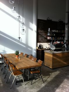 Hopper Coffee | Rotterdam Love the long dining table setting, polished concrete floor and light fittings