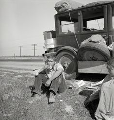 """""""That boy of mine"""": 1936.  Depression refugee family from Tulsa, Oklahoma. Arrived in California June 1936. Mother and three half-grown children; no father. Says the mother: Anybody wants to work can get by. But if a person loses their faith in the soil like so many of them back there in Oklahoma, then there aint no hope for them. Were making it all right here, all but for the schooling, cause that boy of mine, he wants to go to the University. by Dorothea Lange"""