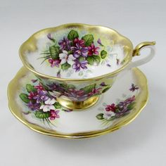 Beautiful Royal Albert cup and saucer with heavy gold gilt and purple flowers, part of the Treasure Chest series. Gold trimming on cup and saucer edges. Excellent condition (see photos). The markings read: Royal Albert Bone China England Treasure Chest Series Please bear in mind that