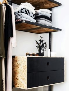 Home-built shelves made of old floorboards, while the drawers are built by OSB-tree and fronts in black oiled MDF.
