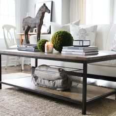Styling Your Coffee Table {Coffee Table Decor} - Tip Junkie: That giant horse would get in the way of me watching TV, but otherwise good tips