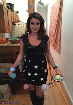 Stephanie: I love space and thought it would be great to be the solar system for this Halloween! I bought a wreath base at the art supply store and made planets...