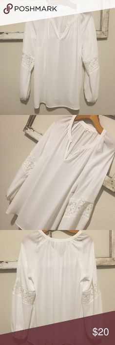 Pleione Blouse Pleione Blouse. White and can be tucked in with shorts or pants. Works both casual and business. Size small but runs more like a medium. Meant to be loose and flowy. Has the cutest lace inset on the sleeves. Brand new with tags and never worn Pleione Tops Blouses
