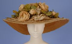 Lace And Straw Wide Brim Hat Made Of Natural Straw With Concentric Bands Of Cream Lace Decorated With Cloth Roses And Daisies   c.1910  -  The Metropolitan Museum Of Art