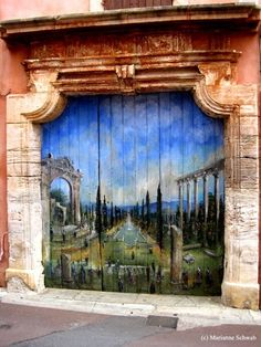door art,,,,,,,,,IT  CERTAINLY IS…….LOOKS LIKE A MURAL INSTEAD OF A DOOR,,,,,,,,,,LOVELY…………..ccp