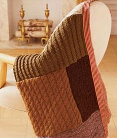 """throw made from sweaters, here 5-6, cut into large rectangles with smaller ones joined to make larger ones, 1/2"""" seam allowance with tight zigzag stitch... backed with fabric a little too wide on ea side which is pulled around to front and sewn as faux binding"""
