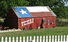 Love thinking about the Texas pride someone had while painting this old red barn.